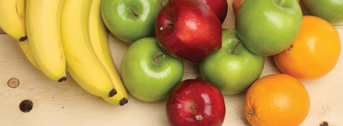 Assorted fresh fruit on wood.