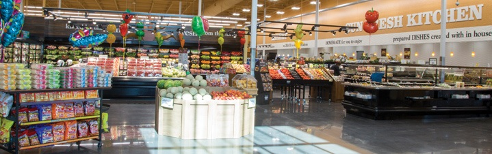 Photo of salad bar and prepared food counter.
