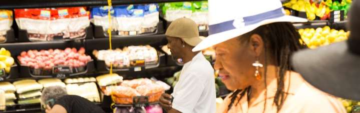 Photo of customers shopping in the produce dept.